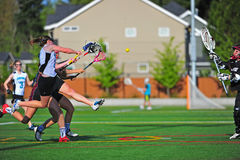 Lacrosse girls Shot on goal royalty free stock image