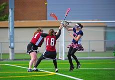 Lacrosse girls shot over block Stock Image