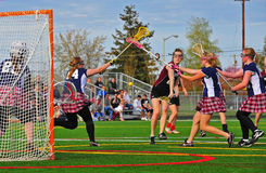 Lacrosse girls shot under the block Royalty Free Stock Photography