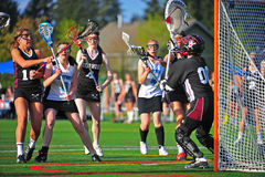 Lacrosse girls stop at the crease Royalty Free Stock Images