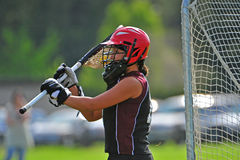 Lacrosse Goalie 1. High School girls lacrosse goalie passing the ball to a team mate after a save Royalty Free Stock Photo