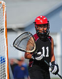 Lacrosse Goalie 11. High School girls lacrosse goalie watching player behind the goal Royalty Free Stock Photography