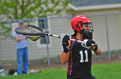 Lacrosse Goalie 3. High School girls lacrosse goalie passing the ball to a teammate after a save Stock Photo