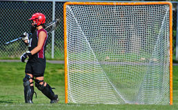 Lacrosse Goalie. High School girls lacrosse goalie waking off the field at half time Stock Images