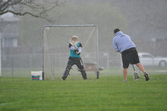 Lacrosse Goalie ball block. April 9, 2008. OGLA (Oregon Girls Lacrosse Association) Hilsboro's Century High School goalie blocks a practice shot from her coach Royalty Free Stock Photography
