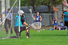 Lacrosse goalie block Royalty Free Stock Images