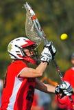 Lacrosse goalie bolcks a ball Stock Photo