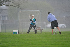 Lacrosse goalie practice. April 9, 2008. OGLA (Oregon Girls Lacrosse Association) Hillsboro's Century High School varsity coach warming up the gaolie on a misty Royalty Free Stock Image