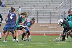 Lacrosse goalie recovers the ball Stock Photography