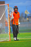 Lacrosse Goalie standing guard. Boys High School Lacrosse goalie moves around to follow the ball, keeping guard stock photos