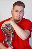 Lacrosse gracza mienie na jego kiju Obraz Stock