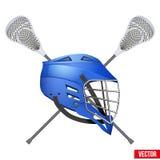 Lacrosse helmet and sticks Royalty Free Stock Photos