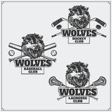 Lacrosse, honkbal en hockeyemblemen en etiketten De emblemen van de sportclub met hoofd van wolf Royalty-vrije Stock Foto's
