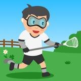 Lacrosse-Junge im Park Stockfotografie