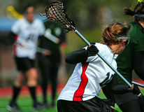 Lacrosse player 3. College womens lacrosse player on the attack Royalty Free Stock Photos