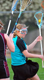 Lacrosse player 4. High School Girls lacrosse player looking for a way around defenders Royalty Free Stock Images