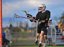 Lacrosse player assist Stock Photo