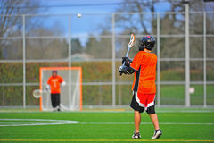Lacrosse player catching ball Royalty Free Stock Photo