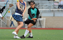 Lacrosse player checking opponent Royalty Free Stock Images