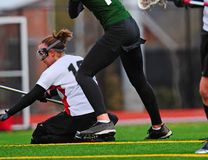 Lacrosse player down. College womens lacrosse player down durring a play Stock Photo