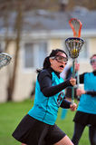 Lacrosse player with eye on the ball Stock Photos