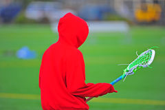 Lacrosse player in a red hoodie stock images