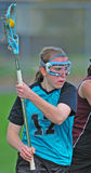 Lacrosse players with the ball Royalty Free Stock Photos