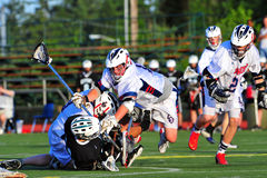 Lacrosse prenant en bas d'une pointe Photo libre de droits