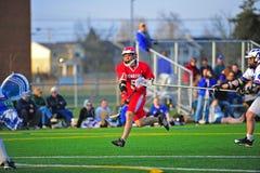 Lacrosse que bloquea un tiro en meta Fotografía de archivo