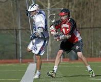 Lacrosse que funciona con la línea Foto de archivo libre de regalías