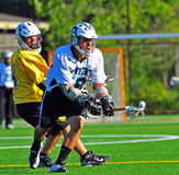Lacrosse reach for the ball Royalty Free Stock Images