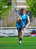 Lacrosse Running to the camera with the ball Stock Images