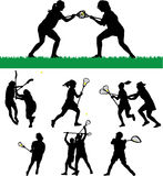 Lacrosse-Schattenbilder der Frauen Stockfoto