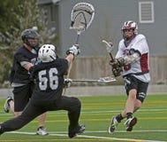 Lacrosse schoss durch bhe Tormann lizenzfreies stockfoto
