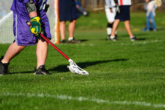Lacrosse scooping the ball Stock Photo