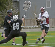 Lacrosse shot by bhe goalie Royalty Free Stock Photo