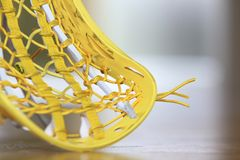 Lacrosse stick. Yellow lacrosse head with yellow string Stock Photos