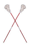 Lacrosse sticks. Worn lacrosse sticks crossed isolated over white royalty free stock photography