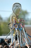 Girls High School Lacrosse. Lacrosse Sticks being raised before a start of a game stock images