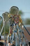 Girls High School Lacrosse. Lacrosse Sticks being raised before a start of a game stock photo