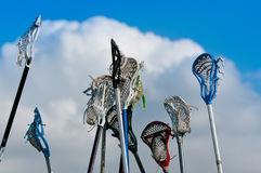 Lacrosse sticks in the Sky. Many lacrosse sticks and heads held high in sky stock images