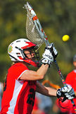 Lacrosse-Tormann bolcks eine Kugel Stockfoto