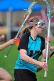 lacrosseflyttningsspelare Royaltyfri Foto