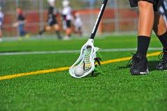 Lacrossekugel heben auf lizenzfreies stockbild