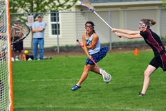 Lacrossemädchen-Unischuß mj Stockfotografie