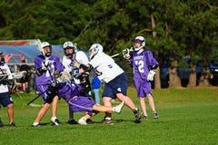 Lacrossespielerstoppen Stockfotos