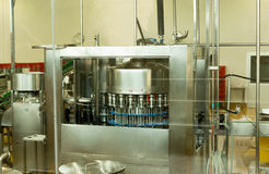 Lactose Filling machine for bottle of milk. In factory Stock Photo