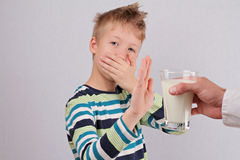 Lactose intolerance. Dairy Intolerant child refuses to drink milk Stock Images