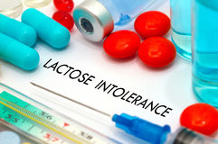 Lactose intolerance. Treatment and prevention of disease. Syringe and vaccine. Medical concept. Selective focus Stock Image