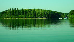 Lacustrine Landscape.Green Forest Reflections On Rippling Lake Waters stock video footage